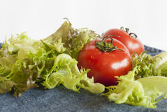 Fresh  washed vegetables. Fresh washed vegetables: tomatos and greens; selective focus Stock Photo