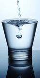 Fresh water. Glas of pouring water with reflection Stock Photo