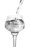 Fresh water being poured into glass Royalty Free Stock Photos