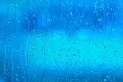Fresh water on a blue window Stock Photos