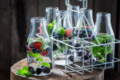 Fresh water in bottle with raspberries, blueberries and blackberries Stock Images