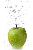 Fresh water drops on green apple isolated on white Royalty Free Stock Images