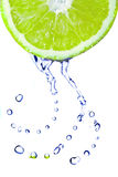 Fresh water drops on lime Stock Photos
