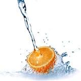 Fresh water drops on orange isolated on white Stock Photo