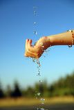 Fresh water falling on children hands Stock Images