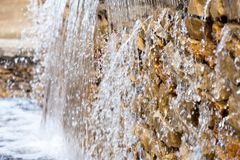 Fresh water falling down. On rocks royalty free stock images
