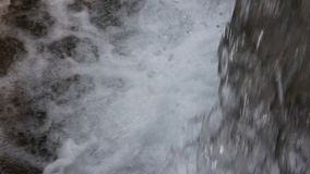 Fresh water that falls from the waterfall stock footage