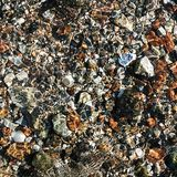 Fresh water flowing over pebbles Royalty Free Stock Photos