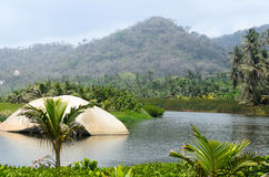 Fresh water lagoon surrounded by green hills and jungle Royalty Free Stock Image