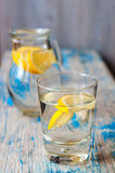 Fresh water with lemon in the glass. Cold fresh water with lemon in the glass Royalty Free Stock Photo