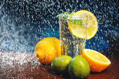 Fresh water with lemon, lime, mint and water splashes Royalty Free Stock Photos