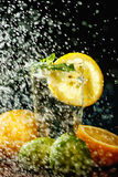 Fresh water with lemon, lime, mint and water splashes Royalty Free Stock Photo