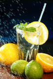Fresh water with lemon, lime, mint and water splashes Royalty Free Stock Images