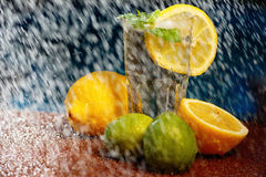 Fresh water with lemon, lime, mint and water splashes. Glass of fresh water with lemon, lime, mint and water splashes Royalty Free Stock Image