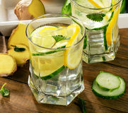 Fresh water with lemon, mint  and cucumber  on a wooden backgrou Stock Photo