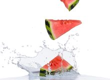 Fresh water melon in water splash on white Stock Photo