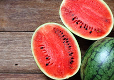 Fresh water melons on wood Stock Images