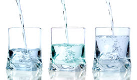 Fresh water pouring in a glass Stock Photography