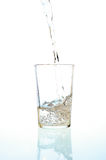 Fresh water pouring into a glass Royalty Free Stock Images