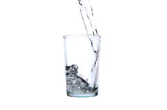 Fresh water pouring into a glass Royalty Free Stock Image