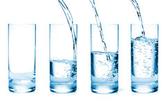 Fresh water pouring in glasses Royalty Free Stock Image