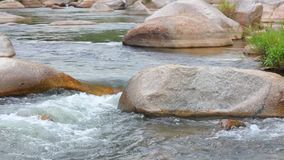 Fresh water river white water high definition. Fresh water mountain river scene with rapid flowing fresh rain water and large boulders, panning camera high stock video footage