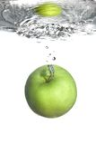 Fresh water splash on green apple Stock Images