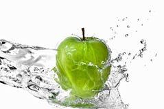 Fresh water splash on green apple Royalty Free Stock Images