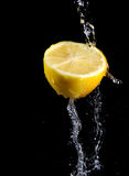 Fresh water splash and lemon Royalty Free Stock Images