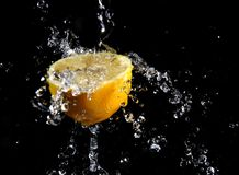 Fresh water splash and lemon. Stock Photos
