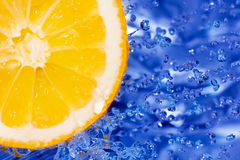 Fresh water splash on orange Royalty Free Stock Images