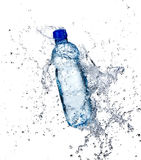 Fresh water splashing out of bottle Stock Photos