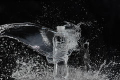 Fresh water splashing out of bottle Royalty Free Stock Image