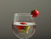 Fresh water with strawberry in glass. Photograph of fresh strawberry with water and glass Stock Photography
