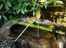 Fresh water for washing hands at the temple in Kyoto, Japan Stock Photography
