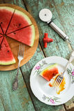 Fresh watermelon as vegan pizza with pizza knife and tire-boucho Royalty Free Stock Image