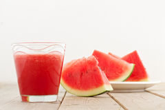 Fresh watermelon blending in glass on wood table Stock Images