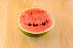 Fresh watermelon fruit on wooden Royalty Free Stock Images