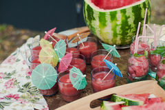 Fresh watermelon juice in the glass on wooden Stock Photos
