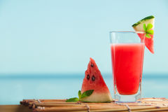 Fresh watermelon juice with mint, lemonade. Healthy drink for summer with vitamins, suits for vegetarian. Sea on the background Stock Photography