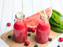 Fresh watermelon juice on a wooden background Royalty Free Stock Images