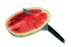 Fresh watermelon with kitchen knife Stock Images