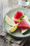Fresh watermelon and lemon on the wooden table Stock Photo