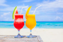 Fresh watermelon and mango cocktails on the background of turquoise sea Stock Photos