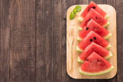 Fresh watermelon pieces placed on wooden background Stock Photos