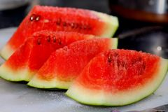 Fresh Watermelon Pieces with Sugar Crystals Stock Images