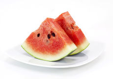 fresh watermelon pieces on white plate Stock Images