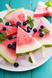 Fresh watermelon popsicles with blueberries Stock Images