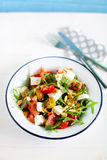 Fresh watermelon salad with arugula, feta, olives and tomato Royalty Free Stock Photography