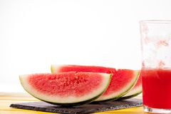 Fresh watermelon slices and juice drink. Thirst quenching refreshing summer smoothie. stock photo